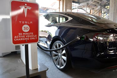 The trip began with a 35-minute charging session at the Tesla Supercharger station at Park Meadows Mall in Lone Tree, Colo. All four Supercharger stations were being used when I filled up at 10:30 a.m. on Monday. [Photo by Christof Demont-Heinrich]