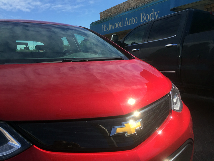 2017 Chevy Bolt parked at Highwood Auto Body in Englewood, Colo.