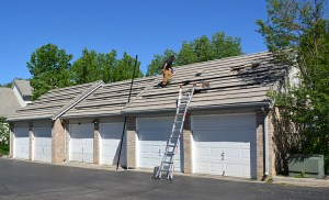 Sopris solar worker on garage roof