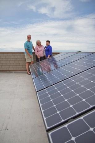 participants next to solar panels