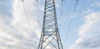 low angle photo of gray transmission tower