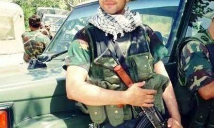 SSG commando smiling holding ak-47 with jeep