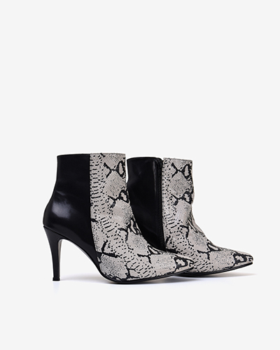 Another product image showing a pair of stiletto boots with a snake print material