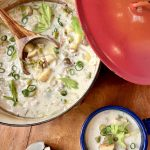 creamy clam chowder in a pot and a soup crock
