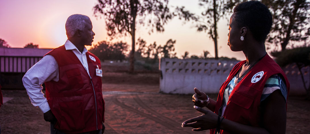 Red Cross staff at sunset