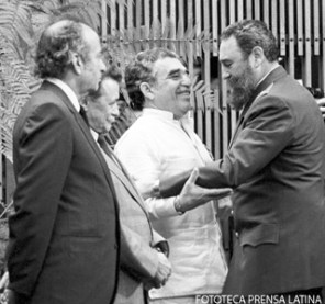 Cuban leader Fidel Castro, right, greets Colombian writer Gabriel Garcia Marquez, center, during a decoration ceremony in Havana, Cuba, Jan. 6, 1983. (AP Photo/Prensa Latina via AP Images/Miguel Vinas)