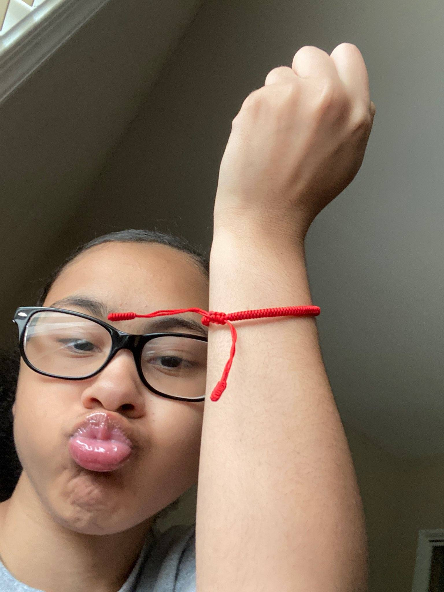 Wearing the Red String Solidarity Bracelet