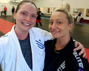 Sarah and her Brazillian Jiu-Jitsu coach at Redline