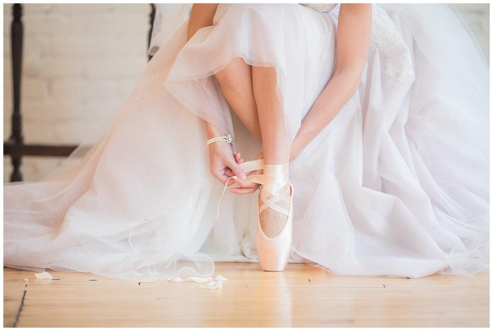 Ballerina bride putting ballerina shoes on during fine art wedding photoshoot in South Dakota
