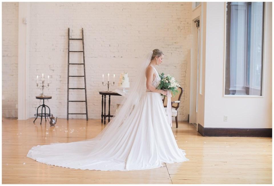 Bride holding flowers during a fine art wedding photoshoot in South Dakota.