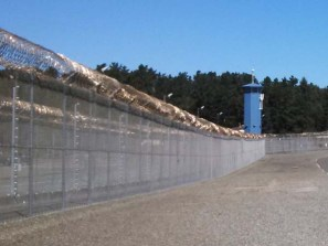 Pelican Bay prison tower and perimiter fence. [Katie Orr - Capital Public Radio]