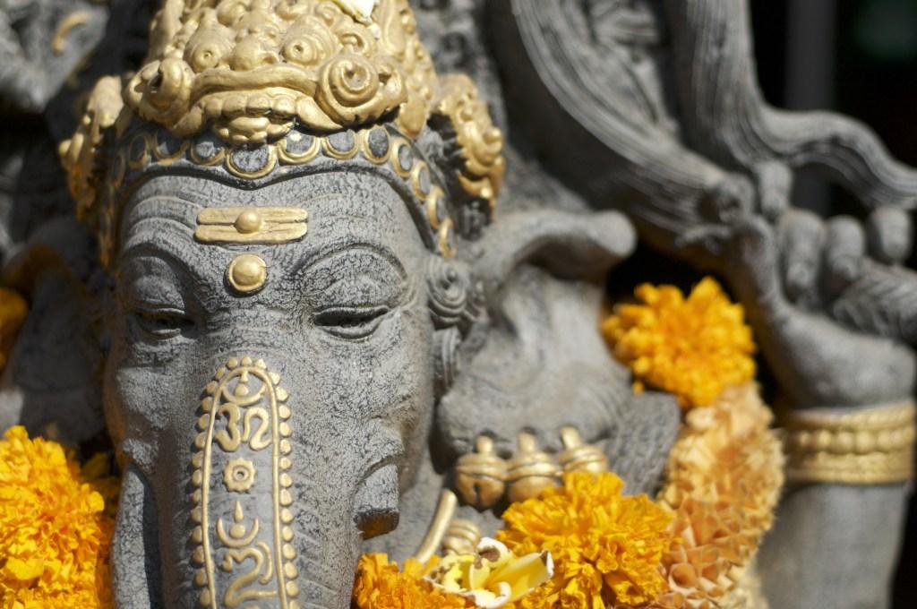 Front head shot of a beautiful Ganesha stone statue