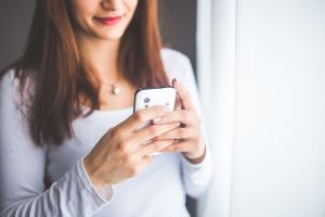 close-up-portrait-of-a-young-woman-typing-a-text-message-on-6400