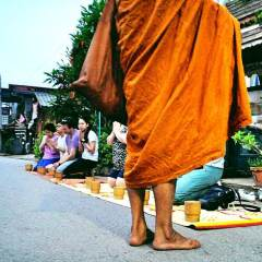 Travel to Thailand: Almsgiving to Monks in Chiang Khan