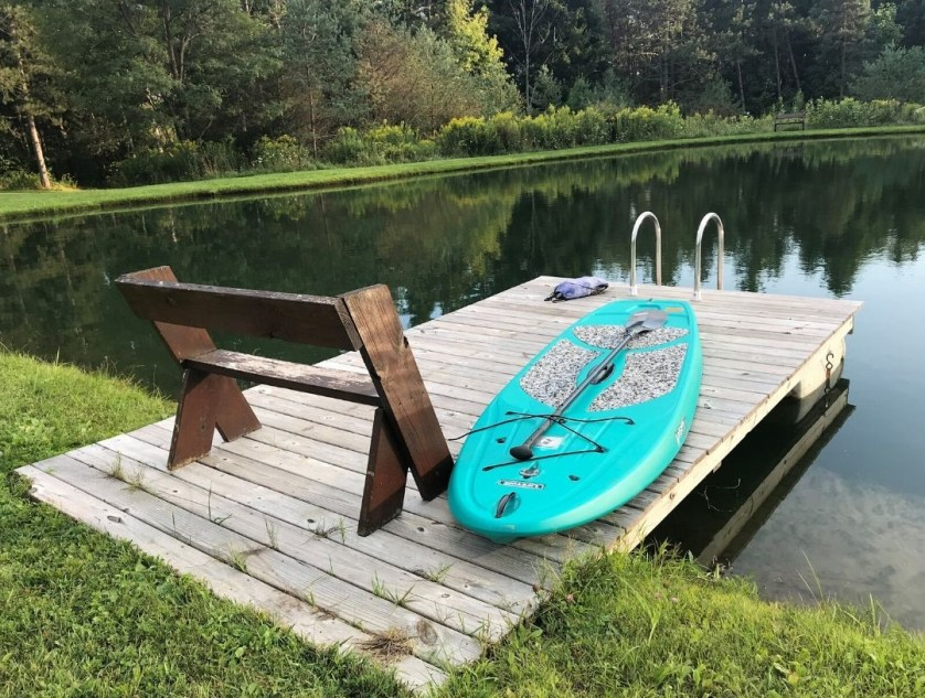 A Welcoming Paddleboard on a Freshwater Pond.