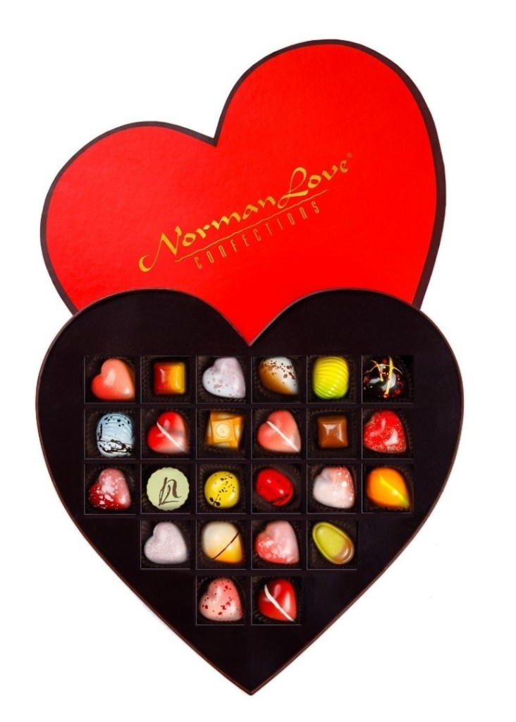"""A Sample from """"Date Night 2021,"""" a Limited-Edition Collection of Heart-Shaped Dark, Milk, and White Chocolates."""