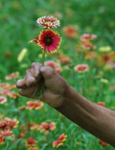 leprosy20patient20holding20flower