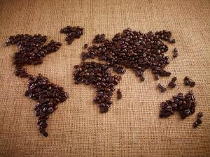 coffee-beans-forming-world-map-on-burlap-adam-gault