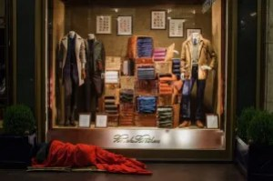 Milan_Italy_Malls_High_End_shopping_Poor_Homeless_Sleeping_Clothes_Retailer_Rich_Divide
