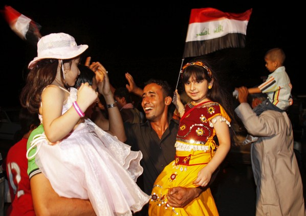 Iraqis celebrate in Basra, Iraq's second-largest city, 550 kilometers (340 miles) southeast of Baghdad, Iraq, Tuesday, June 30, 2009. U.S. troops pulled out of Iraqi cities on Tuesday in the first step toward winding down the American war effort by the end of 2011. (AP Photo/Nabil al-Jurani)