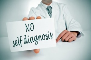 "Doctor in a white lab coat with a ""no self diagnosis"" sign."