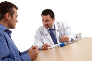 Doctor talking to a man about an IBS diagnosis.