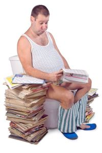 Frustrated, constipated, fat man on the toilet with a big pile of magazines.