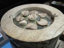 Alabaster lotuses and font