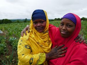 Portrait of two Somali Bantu women in the field at LIberation Farms
