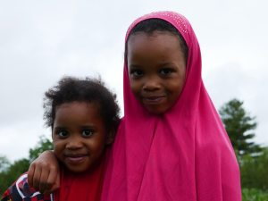 A portrait of two Somali Bantu girls at Liberation Farms