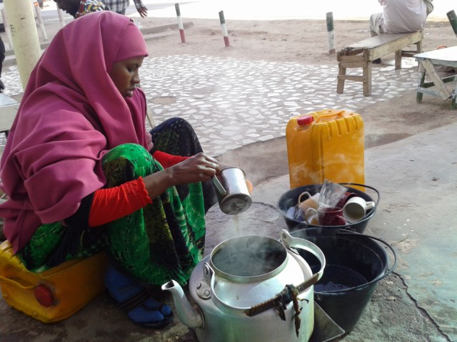 A girl selling tea on the street in Hargeisa