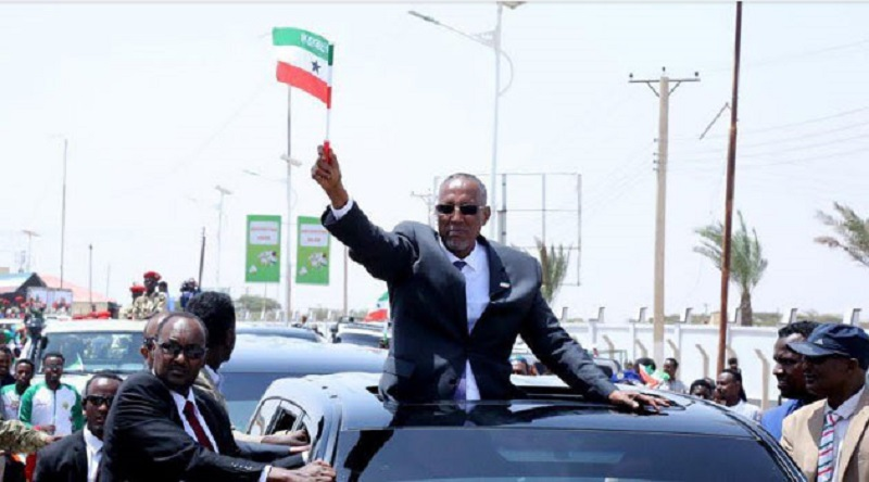Somaliland President Musa Bihi waves a flag in Hargeisa