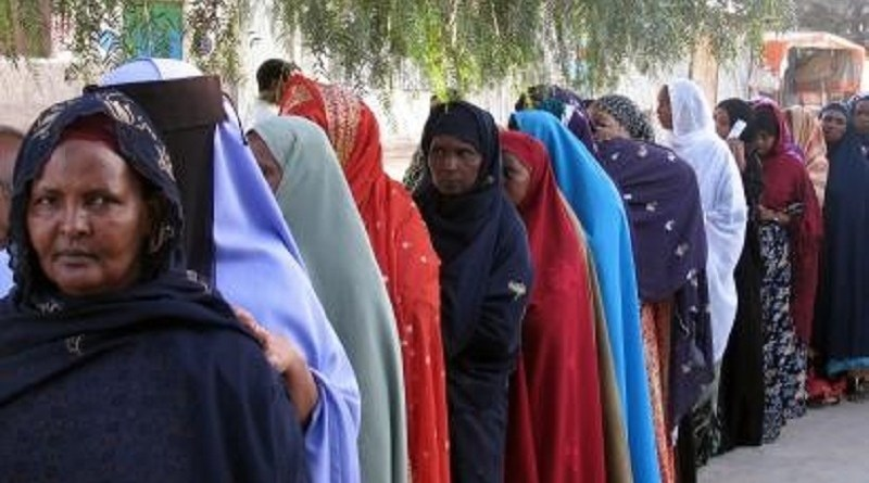 women line up in a queu in order to cast their vote in Somaliland elections