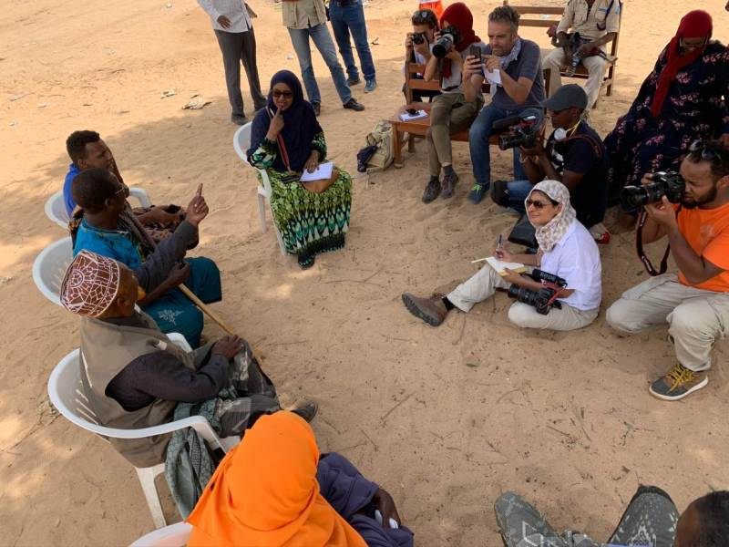 East Africa Correspondent Nita Bhalla (in white) with other journalists interviewing elders in Geerisa village, Somalia, March 5, 2020. THOMSON REUTERS FOUNDATION/Yasin