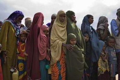 Newly arrived Somali refugees wait to be registered