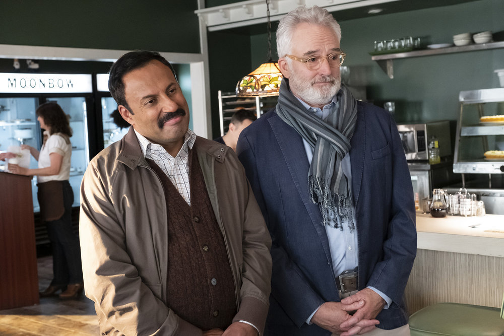 "PERFECT HARMONY -- ""Any Given Monday"" Episode 108 -- Pictured: (l-r) Rizwan Manji as Reverand Jax, Bradley Whitford as Arthur -- (Photo by: Justin Lubin/NBC)"
