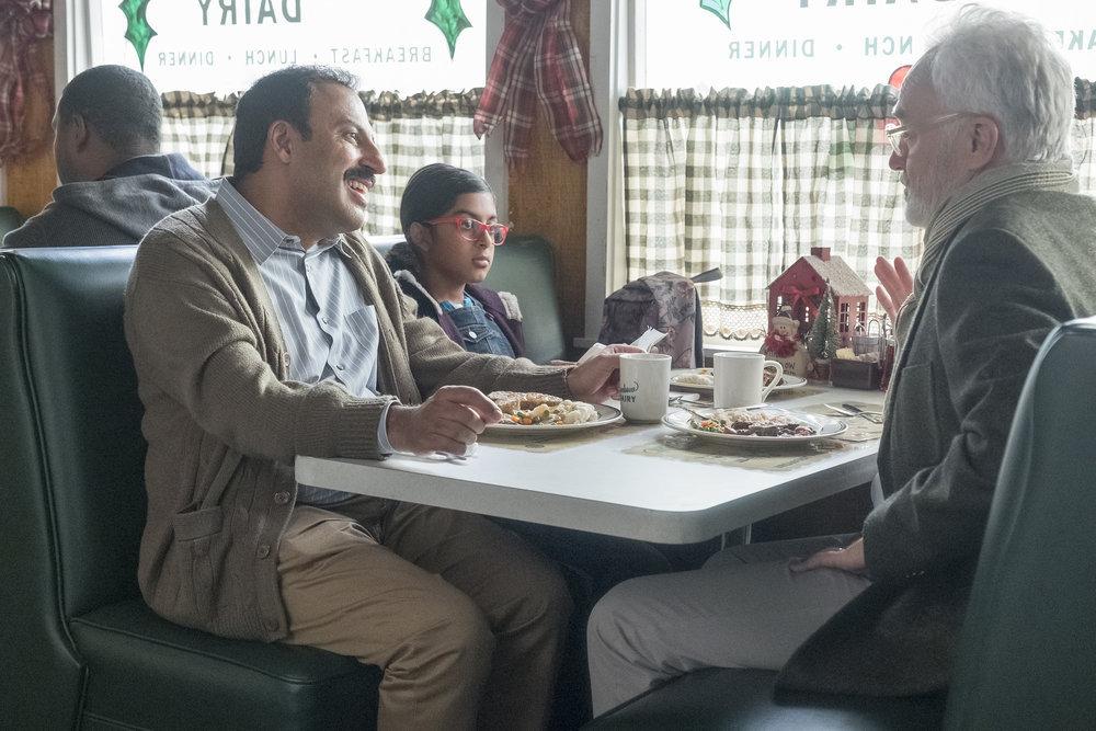 "PERFECT HARMONY -- ""Merry Jaxmas"" Episode 110 -- Pictured: (l-r) Rizwan Manji as Reverend Jax, Ayana Manji as Anjali, Bradley Whitford as Arthur Cochran -- (Photo by: Ron Batzdorff/NBC)"