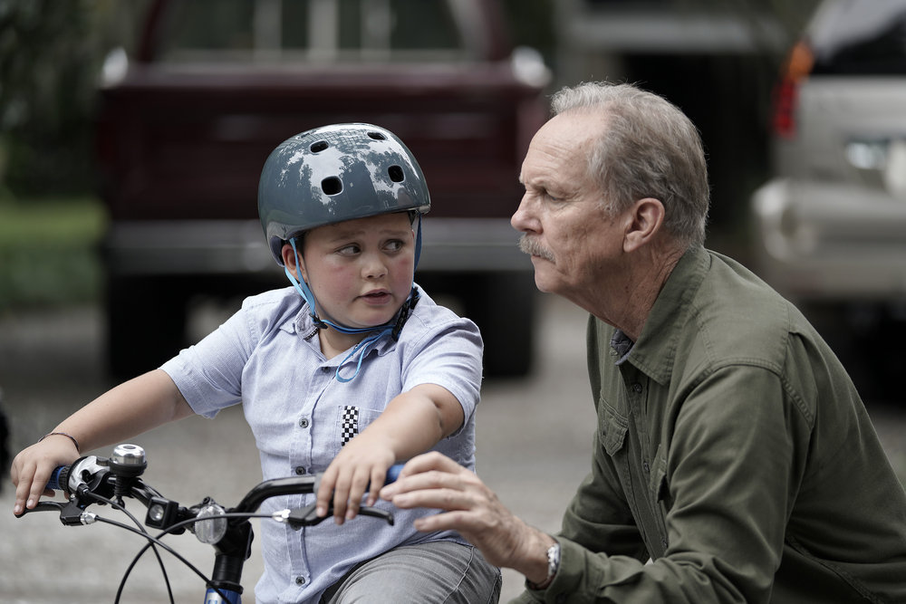 "COUNCIL OF DADS -- ""I'm Not Fine"" Episode 102 -- Pictured: (l-r) Blue Chapman as JJ Perry, Michael O'Neil as Larry Mills -- (Photo by: Seth F. Johnson/NBC)"