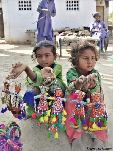 Village girls selling hand made dolls, Nirona Village