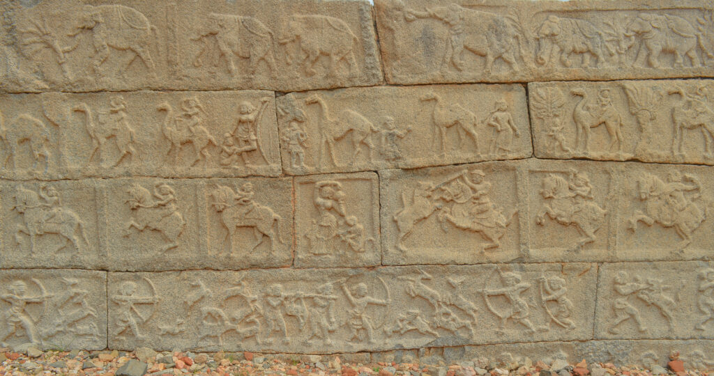Engravings on the walls of the Mahanavami Dibba, Hampi