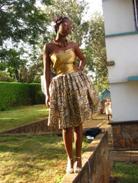 Flattering kitenge dress with tafetta bodice is complemented well by the chunky neckpiece.