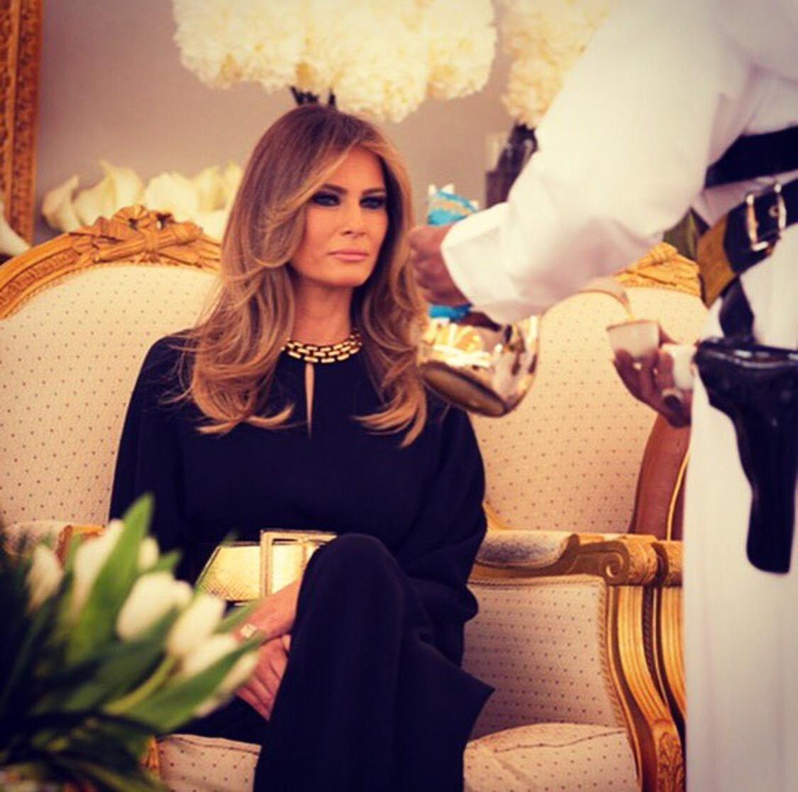 SAUDI ARABIA: Historic Photo of First Lady Melania Trump being served tea by armed Saudi male servant