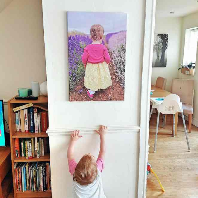 Printerpix review of Magic Mug and discount by Someone's Mum. Small girl looking at canvas picture of herself.