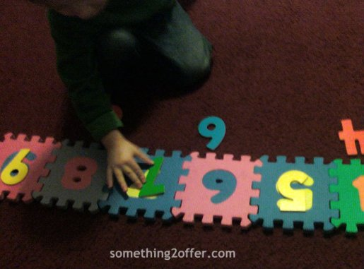 number line with foam puzzle and wooden puzzle