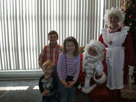 kids with Santa Claus and Mrs. Claus