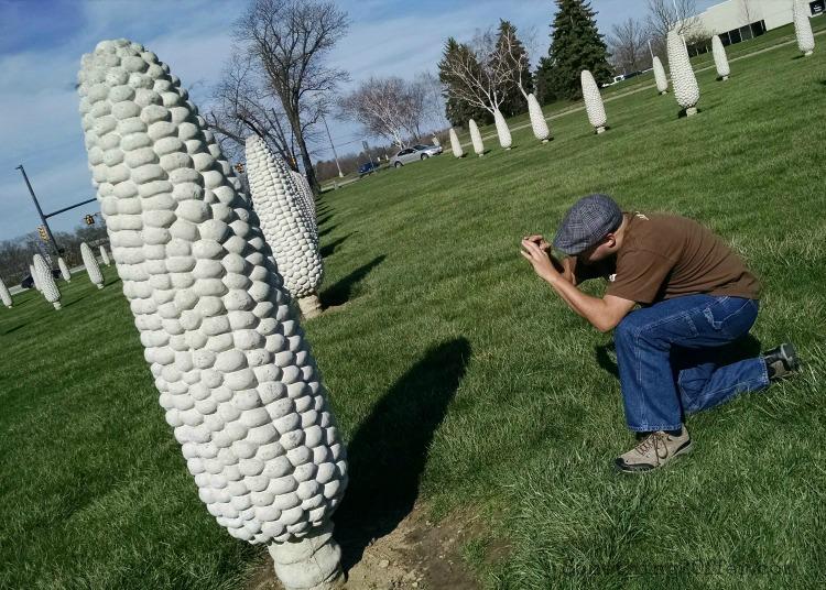 Riley kneeling concrete corn cob