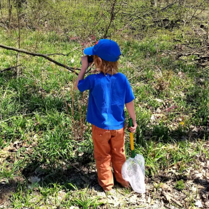 Boy with binoculars and net