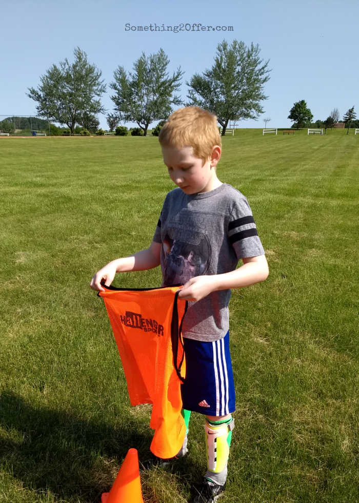 Soccer Camp boy with penny