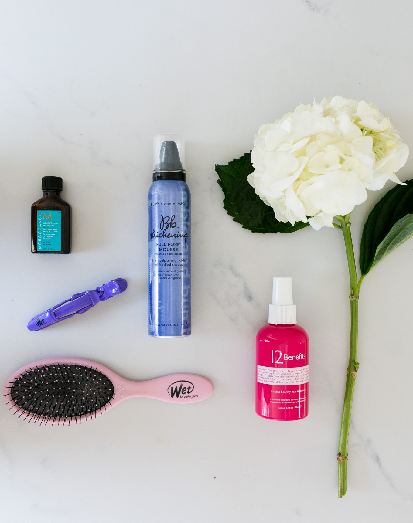 Blogger Daryl-Ann Denner of Something Beautiful share her favorite hair care products to use on wet hair including Moroccan Oil Treatment and Bumble and Bumble Thickening Full Form Mousse