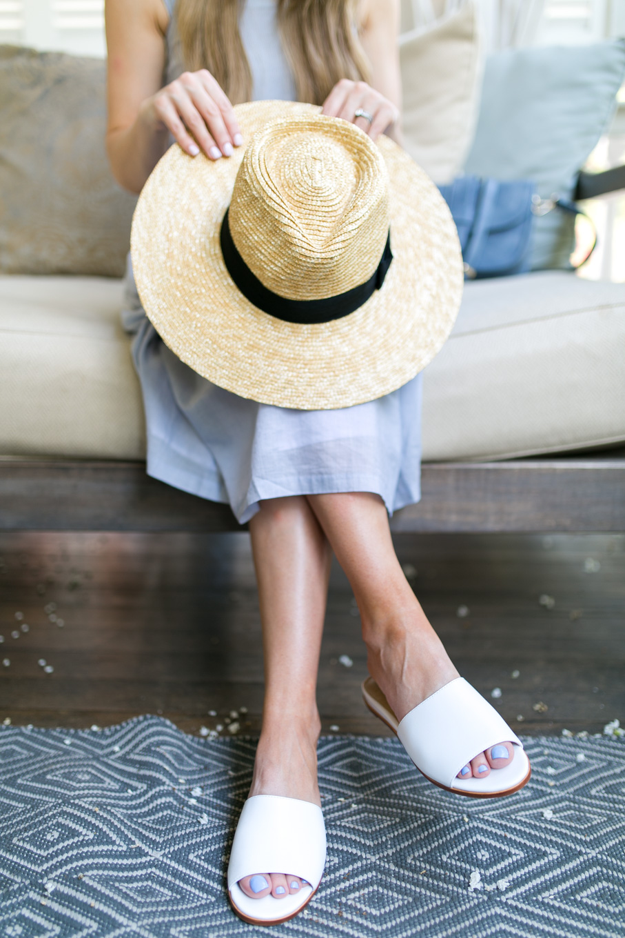Style blogger, Daryl-Ann Denner, wears Brixton Joanna Straw Hat and Marc Fisher Wyndi White Slide Sandals from Nordstrom in Charleston